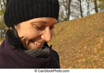 Woman, girl on a walk in the park. Autumn