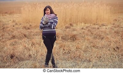 woman girl portrait in sweater scarf and mittens nature...