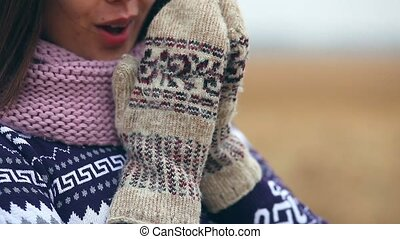 woman girl portrait in sweater scarf and mittens on nature...