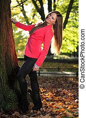 woman girl portret in autumn garden leaf
