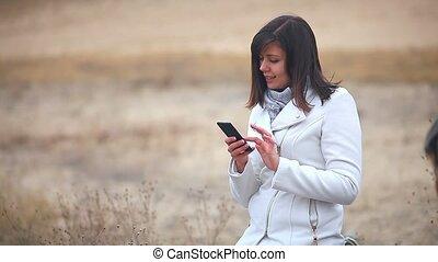 Woman girl searching the internet smart phone social media...