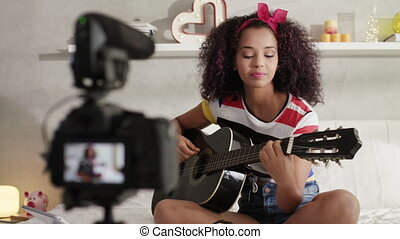 Woman Girving Guitar Class On Internet With Video Tutorial -...