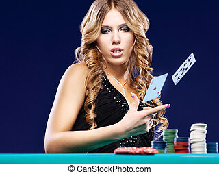 Woman give up in a card gambling match on blue background