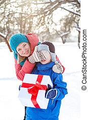 woman gives a Christmas present boy