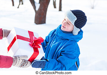 woman gives a Christmas present boy