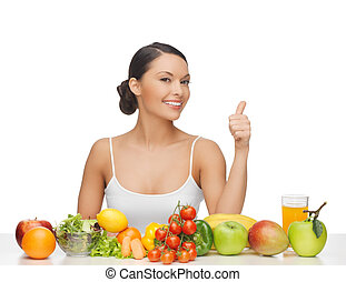 woman gives thumbs up with fruits and vegetables