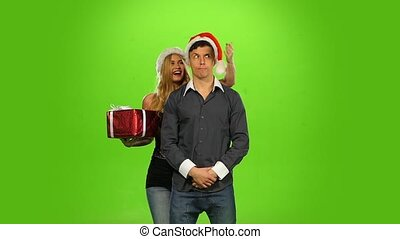 woman giving a Christmas present, surprised boyfriend. green screen,  Slow motion