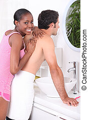 Woman giving a man a massage
