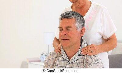 Woman giving a massage to her husba