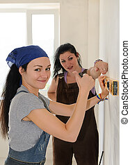 Woman giving a thumbs up while renovating