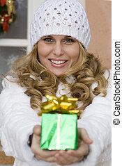 woman giving christmas holiday gift or present