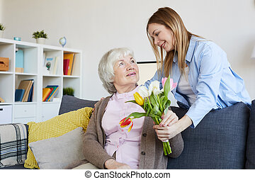 Woman Giving Flowers to Mother