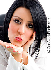 woman giving flying kiss with white background