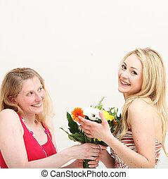 Woman giving her friend a bouquet