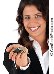 Woman giving keys