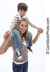 Woman giving little boy piggyback ride