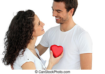 Woman giving man her heart