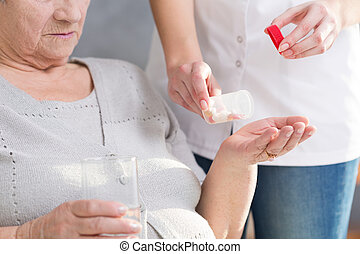 Woman giving medicine