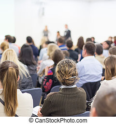 Woman giving presentation on business conference. - Business...