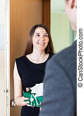 woman giving presentto man