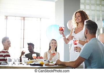 Woman Giving Speech at Banquet