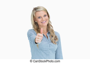Woman giving thumbs up sign