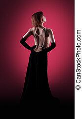 Woman glamour portrait in red dark