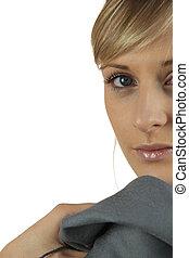 Woman glancing over her shoulder