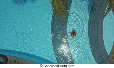 woman goes out pool under tropical tree - Panorama woman in...