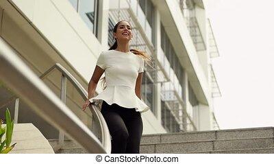Woman Going Downstairs Sliding - Happy hispanic...