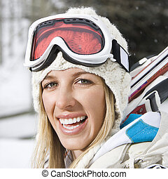 Woman going skiing.