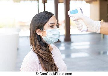 Woman Going Through Body Temperature Test - Caucasian mid ...
