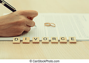 Woman going through divorce and signing papers