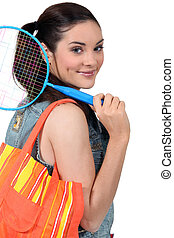 Woman going to play badminton