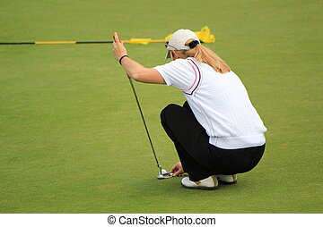 Woman golfer posing ball