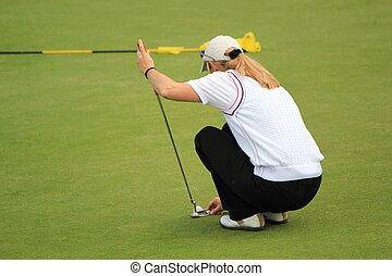 Woman golfer posing ball