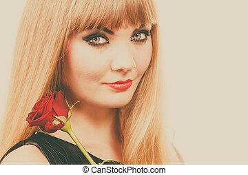 Woman gorgeous girl dark makeup holds rose flower
