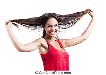 Woman grabbing her hair - Beautiful young woman grabbing her...