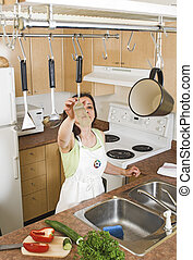 kitchen utensils - woman grabing kitchen utensils