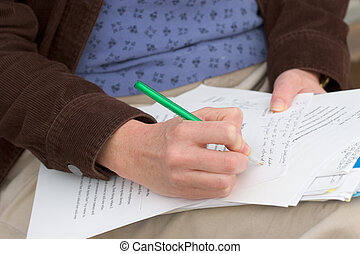 Woman Grading Papers - Photo of a woman grading papers