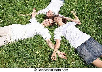 woman grass laying