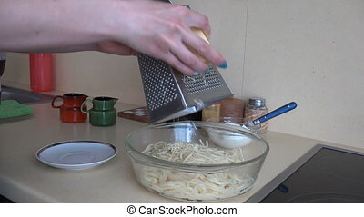 woman grated cheese pasta - woman hand grated cheese on...