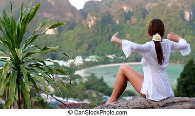 woman greetings sign in ko phi phi island, thailand