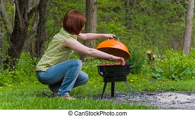 Woman grilling in the park
