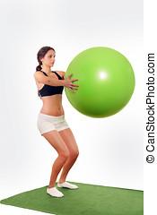 Woman gym ball workout