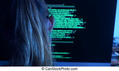 woman hacker writes computer code