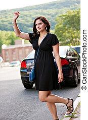 Woman Hailing a Taxi Cab