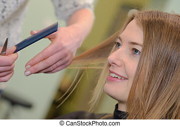 woman haircut at the salon