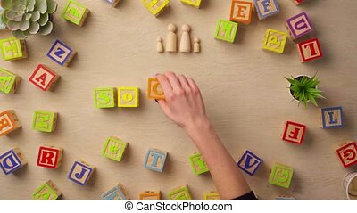 Woman hand arranging wooden cubes with word SOCIETY. High quality 4k footage