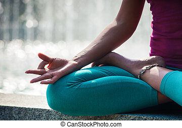 woman hand closeup in lotus yoga position